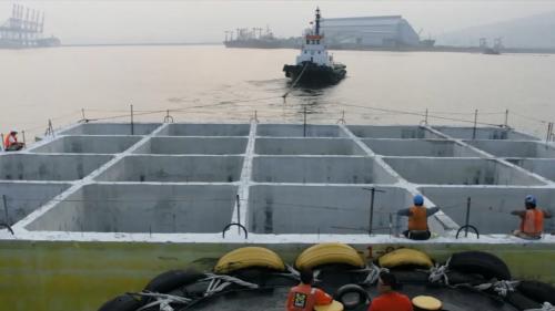 林口電廠擴建所需沈箱在台北港製造後拖至林口電廠途中