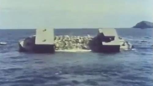 蘇澳港沈箱前礁石炸除後用石塊填補傾斜的海底