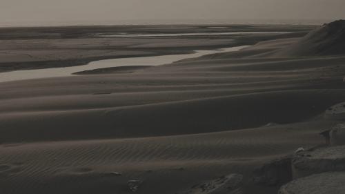 台中港海邊強風吹襲,沙塵滾滾,建港艱難度十倍增
