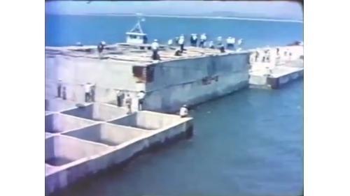台中港第一階段第一期工程沈箱拖放:總計拖放堤防和碼頭沉箱達109座