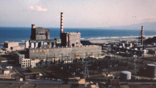 林口電廠舊廠景:北部電力的供應中心的林口電廠,舊林第一、二兩機組分別於 1968 年及 1972年開始商轉起。