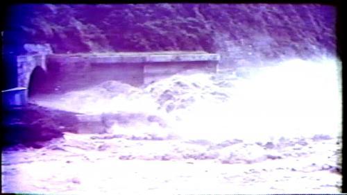 榮工處承辦之曾文水庫導水隧道出口完工遇艾瑞斯颱風(民國59年)來襲的洪水景像